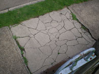 Cracked sidewalk that needs to be repaired